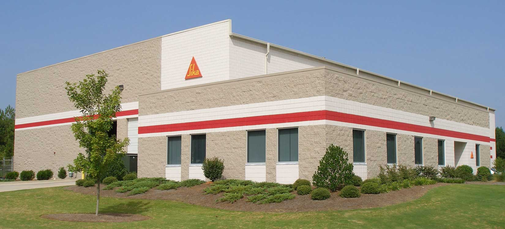 Image of Sika just outside of Atlanta GA.  This is a pre-engineered metal building with a metal roofing system.  Fox Building Company is a commercial construction general contractor specializing in furnish and erect pre-engineered metal building by Nucor Building Systems and Design Build construction.