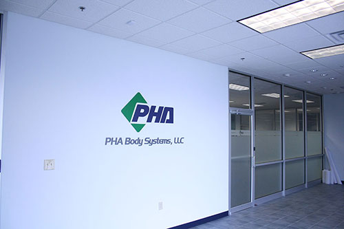 Image of PHA Body Systems' commercial facility entrance.
