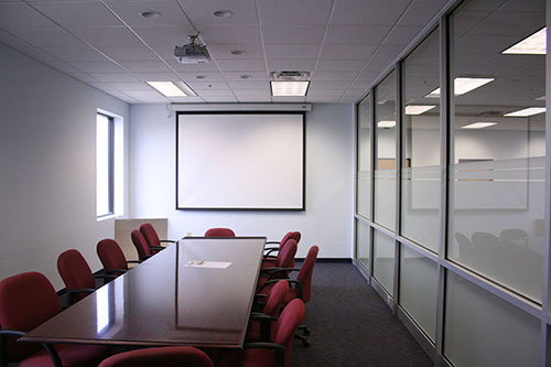 Our commercial interior renovation for PHA Body Systems' includes this modern conference room.